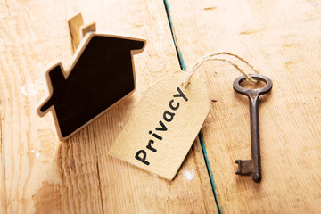 privacy concept - vintage key with tag with inscription