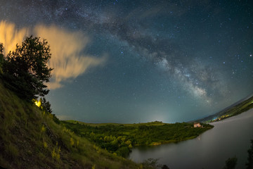 Milky way over lake Cincis in Romania with a fisheye lens