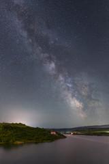 Milky way over lake Cincis in Romania