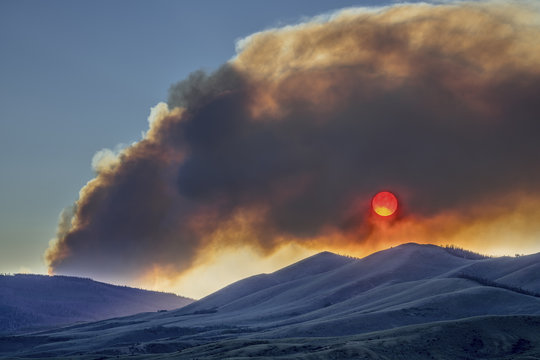 sunset obscured by wildfire smoke