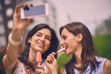 Two Girls making selfie, Outdoors, leisure concept