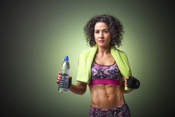 Image of a fit woman holding a bottle of water