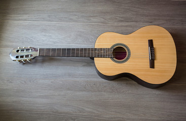 Guitar on wooden background, fretboard