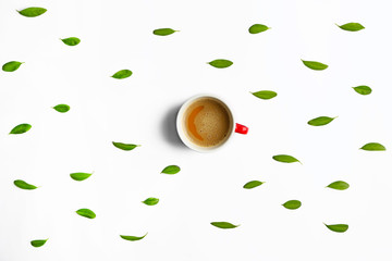 Cup of tasty coffee with leaves on white background