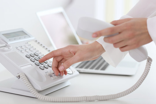 Businesswoman with office IP telephone