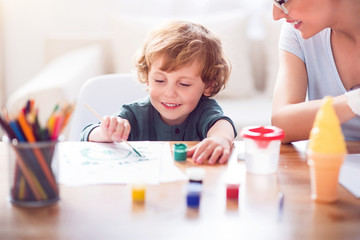 Little boy painting a picture
