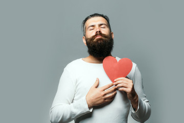 romantic man with paper heart
