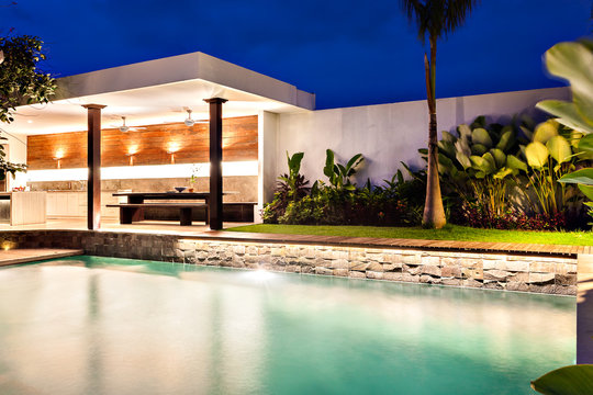 Modern home with a style swimming pool at night