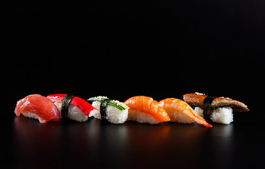 Japanese seafood sushi, on black background