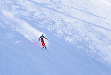 Skier on the slopes of the ski resort