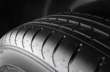 Sipes and grooves on summer tire detailed stock photo