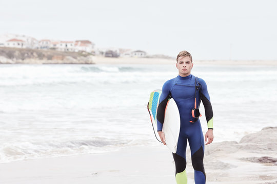 Young surfer on beach