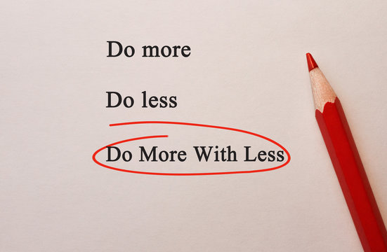 Do More With Less in red circle with pencil on textured paper