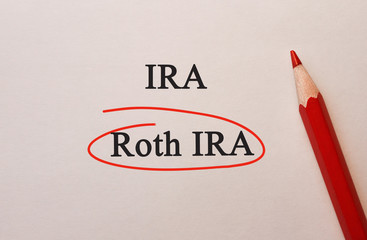 Roth IRA in red circle with pencil on textured paper