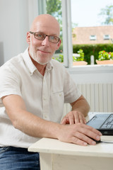 portrait of a middle age man with laptop