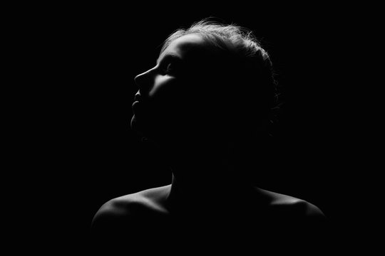 female profile on black