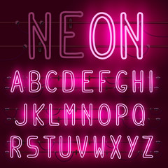 Vector set of realistic neon letters of the english alphabet wit