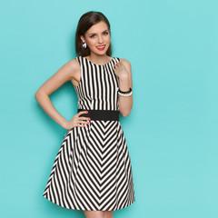 Elegant Woman Posing In Striped Dress