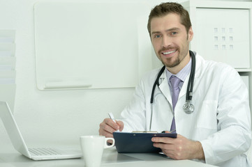 Medical doctor working with laptop