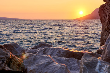 Photo sur Toile Canyon Rock island at sunset in small mediterranean town Brela , Croati