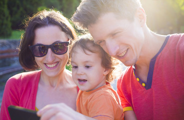 Young and happy family taking a selfie.