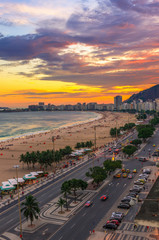 Sunset view of Copacabana beach and Avenida Atlantica in Rio de Janeiro, Brazil