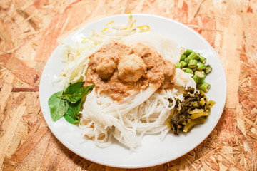 Rice noodles in fish curry sauce (Kanom Jeen Nam Ya).