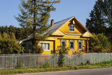 Yellow country wooden house