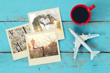 travel instant photographs next to cup of coffee and airplane