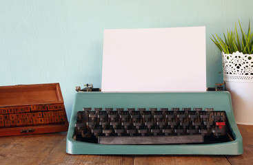 Photo of vintage typewriter with blank page