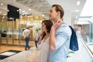 Couple walking in a shopping mall and having fun