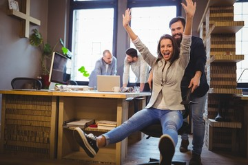 Happy coworkers enjoying in creative office