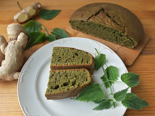 Nettles green round bread, weed dough, wild plants cooking