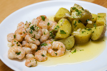 "Spanish food: garlic prawns ""gambas al ajillo"" with potatoes."
