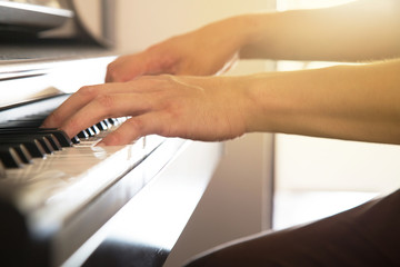 A man's hand playing piano