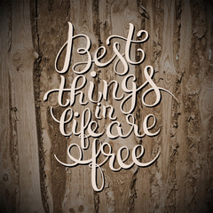 best thinks in life are free inspirational quote on wooden textu