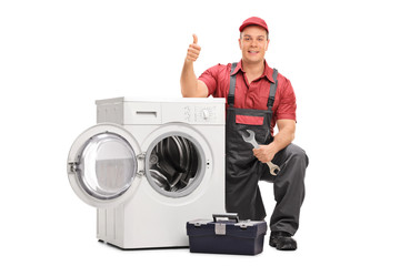 Worker repairing broken washing machine