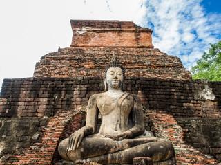 An ancient buddha statue at Mahathat Temple in Sukhothai Historical Park, Sukhothai, Thailand.