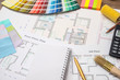 Color samples with house plan, calculator and pen