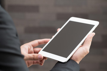Closeup of businessman holding digital tablet with blank Screen