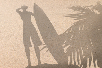Sand Beach with Men Surfer Shadow and Coconut Tree Shadow Background