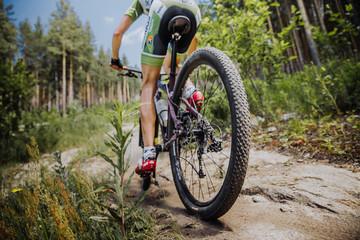 male athlete cyclist riding a bike, rear wheel