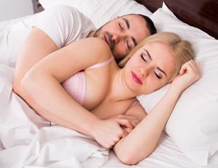 man and blond woman sleeping