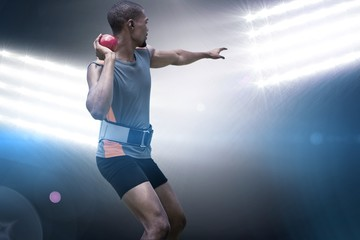 Composite image of rear view of sportsman practising shot put  Wall mural