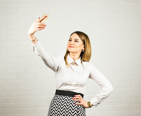 Happy business woman taking selfie photo smartphone. Technology and people concept