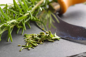 Rosemary chopped cutter slate / Rosemary with herb cutter on a slate base