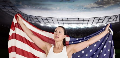 Composite image of female athlete posing with american flag