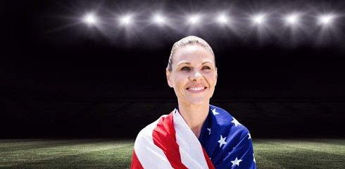 Composite image of portrait of american sportswoman is smiling