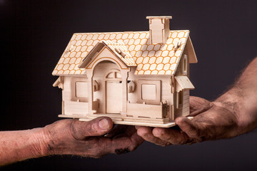 farmer holding a house in his hands