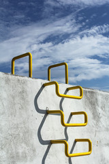 yellow ladder on the quay at the port